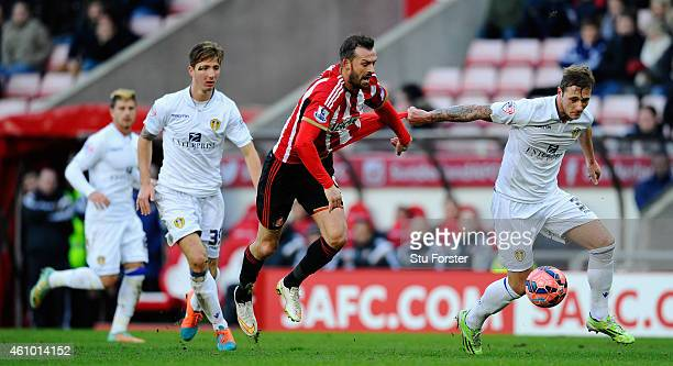 Leeds player Liam Cooper battles for the ball against Steven Fletcher of Sunderland during the FA Cup Third Round match between Sunderland and Leeds...