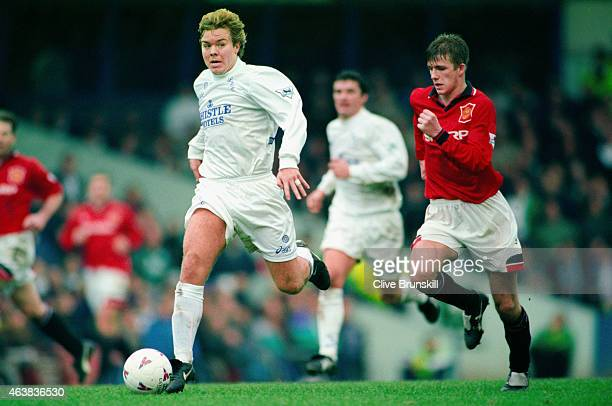 Leeds player Tomas Brolin pulls away from David Beckham during a Premier League match between Leeds United and Manchester United at Elland Road on...