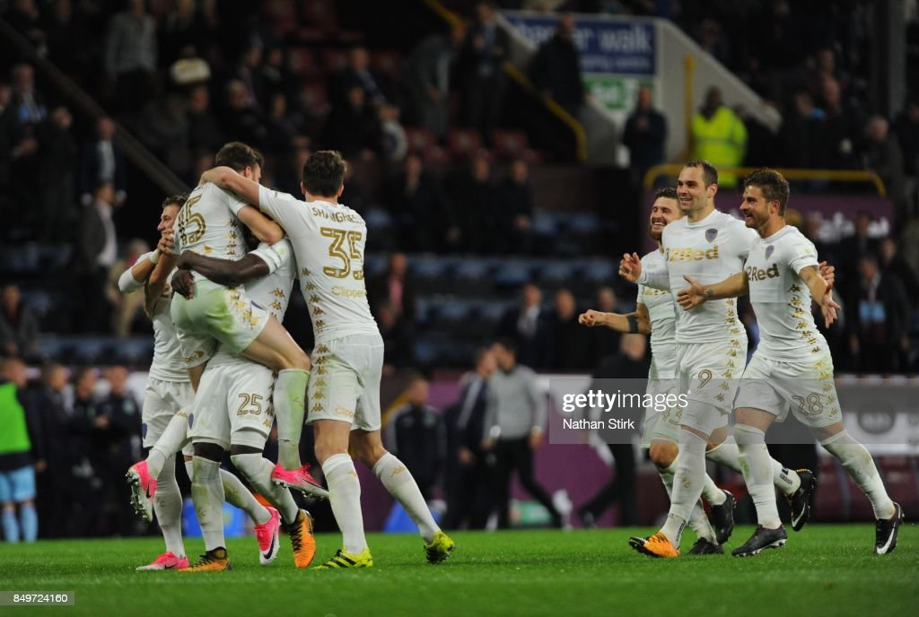 Leeds players celebrate after beating Burnley on penalties during the Carabao Cup Third Round match between Burnley and Leeds United at Turf Moor on September 19, 2017 in Burnley, England.