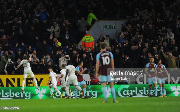 Leeds players celebrate after Pablo Hernández goal during the Carabao Cup Third Round match between Burnley and Leeds United at Turf Moor on...
