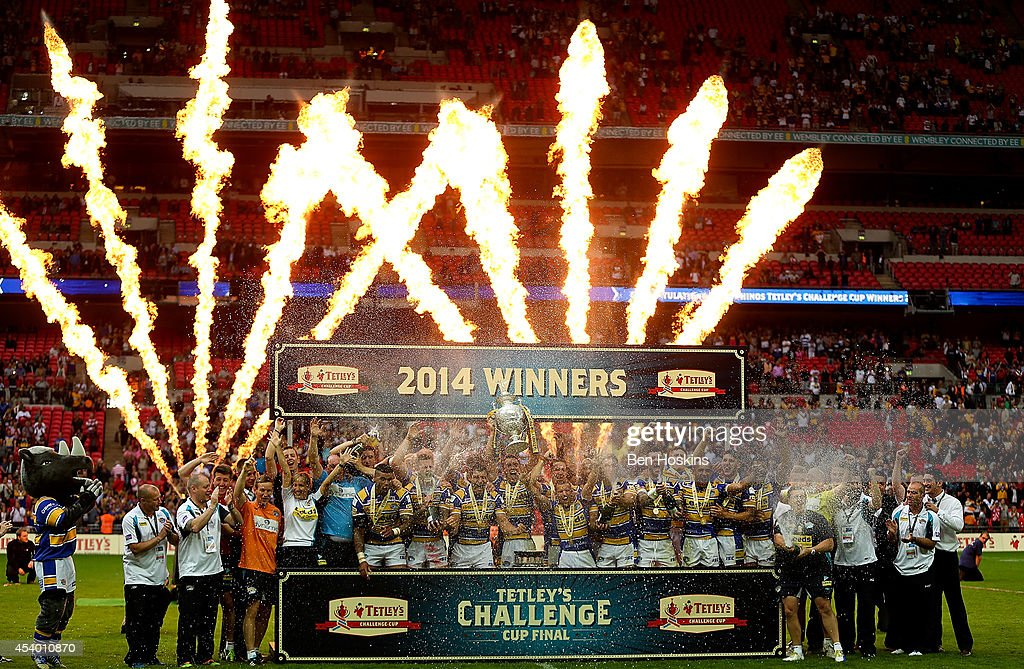 Leeds players celebrate with the trophy after winning the Tetley's Challenge Cup Final between Leeds Rhinos and Castleford Tigers at Wembley Stadium on August 23, 2014 in London, England.