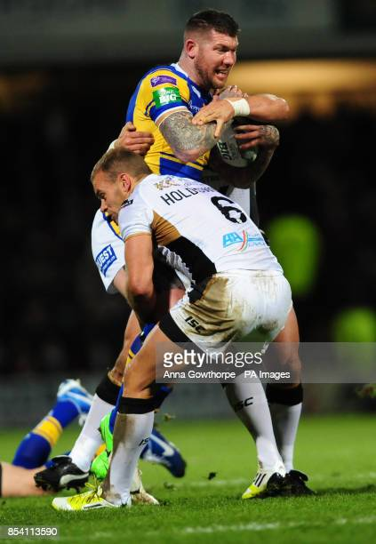 Leeds Rhinos Brett Delaney is tackled by Hull FC's Daniel Holdsworth during the Super League match at Headingley Carnegie Stadium Leeds