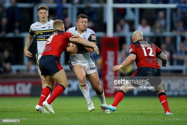 Leeds Rhino's Brett Ferres charges at the featherstone defence during the Ladbrokes Challenge Cup quarterfinal match at Headingley Carnegie Stadium...