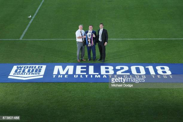 Leeds Rhino's CEO Gary Hetherington Sports Minister John Eren MP and Storm CEO Dave Donaghy pose with the World Club Challenge Trophy during a...