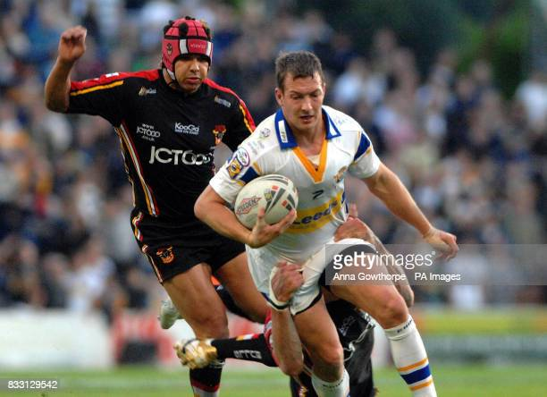 Leeds Rhinos Danny McGuire is tackled by Bradford's Glenn Morrison during the engage Super League match at Headingley Leeds