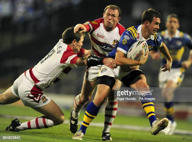 Leeds Rhinos' Danny McGuire is tackled by Wigan Warriors' Mickey Higham and Stuart Fielden during the Engage Super League Grand Final Eliminator at...