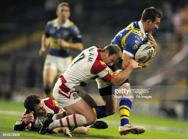 Leeds Rhinos' Danny McGuire is tackled by Wigan Warriors' Mickey Higham during the Engage Super League Grand Final Eliminator at Headingley Carnegie...