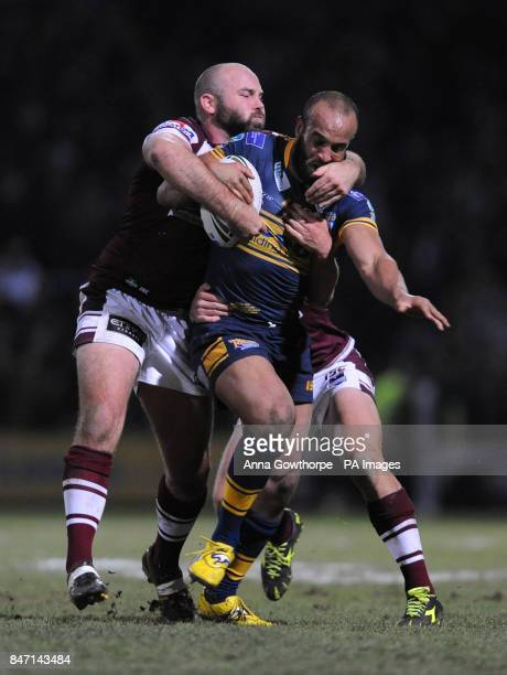 Leeds Rhinos' Jamie JonesBuchanan is tackled by Manly Sea Eagles' Glenn Stewart and Daly CherryEvans during the World Club Challenge match at...