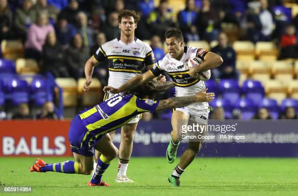 Leeds Rhinos' Joel Moon is tackled by Warrington Wolves' Ashton Sims during the Betfred Super League match at the Halliwell Jones Stadium Warrington
