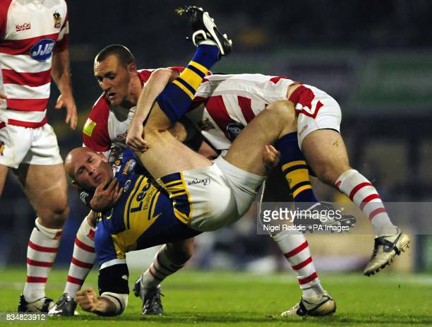 Leeds Rhinos' Keith Senior is tackled by Wigan Warriors' Cameron Phelps and Gareth Hock during the Engage Super League Grand Final Eliminator at...