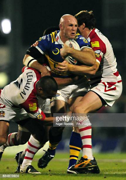 Leeds Rhinos' Keith Senior is tackled by Wigan Warriors' Thomas Leuluai and Andy Coley during the Engage Super League Grand Final Eliminator at...