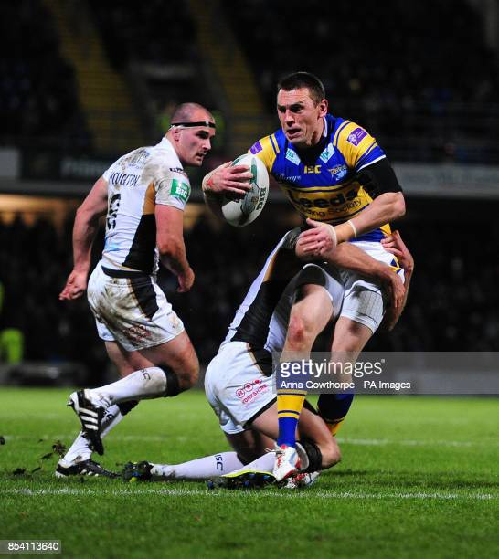 Leeds Rhinos' Kevin Sinfield is tackled by Hull FC's Daniel Holdsworth during the Super League match at Headingley Carnegie Stadium Leeds