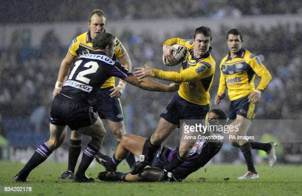 Leeds Rhinos' Matt Diskin is tackled by Melbourne Storm's Adam Blair and Ryan Hoffman during the Carnegie World Club Challenge match at Elland Road...
