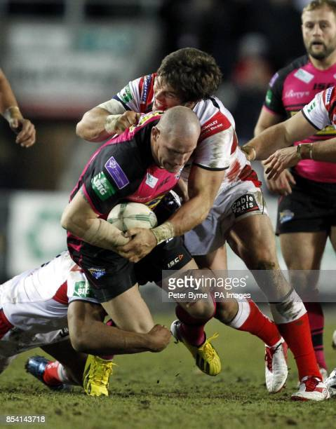 Leeds Rhino's Richard Moore is tackled by St Helens Louie McCartheyScarsbrook during the Super League match at Langtree Park St Helens