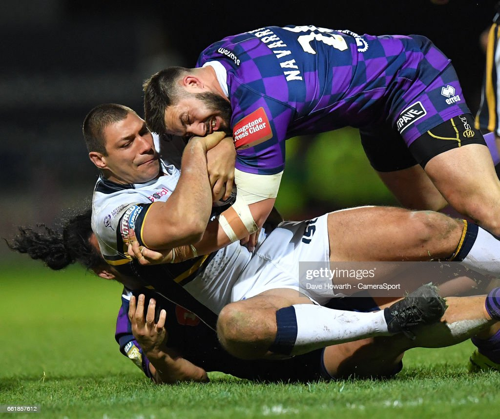 Leeds Rhinos's Ryan Hall is tackled by Wigan Warriors' Romain Navarrete during the Betfred Super League Round 7 match between Leeds Rhinos and Wigan Warriors at Headingley Carnegie Stadium on March 31, 2017 in Leeds, England.