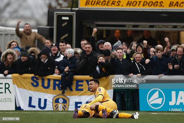 Leeds supporters gesture as Sutton players think they've scored but their 'goal' was disallowed during the English FA Cup fourth round football match...