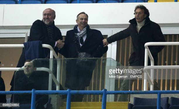 Leeds United banned owner Massimo Cellino pulls on the arm of sporting director Nicola Salerno