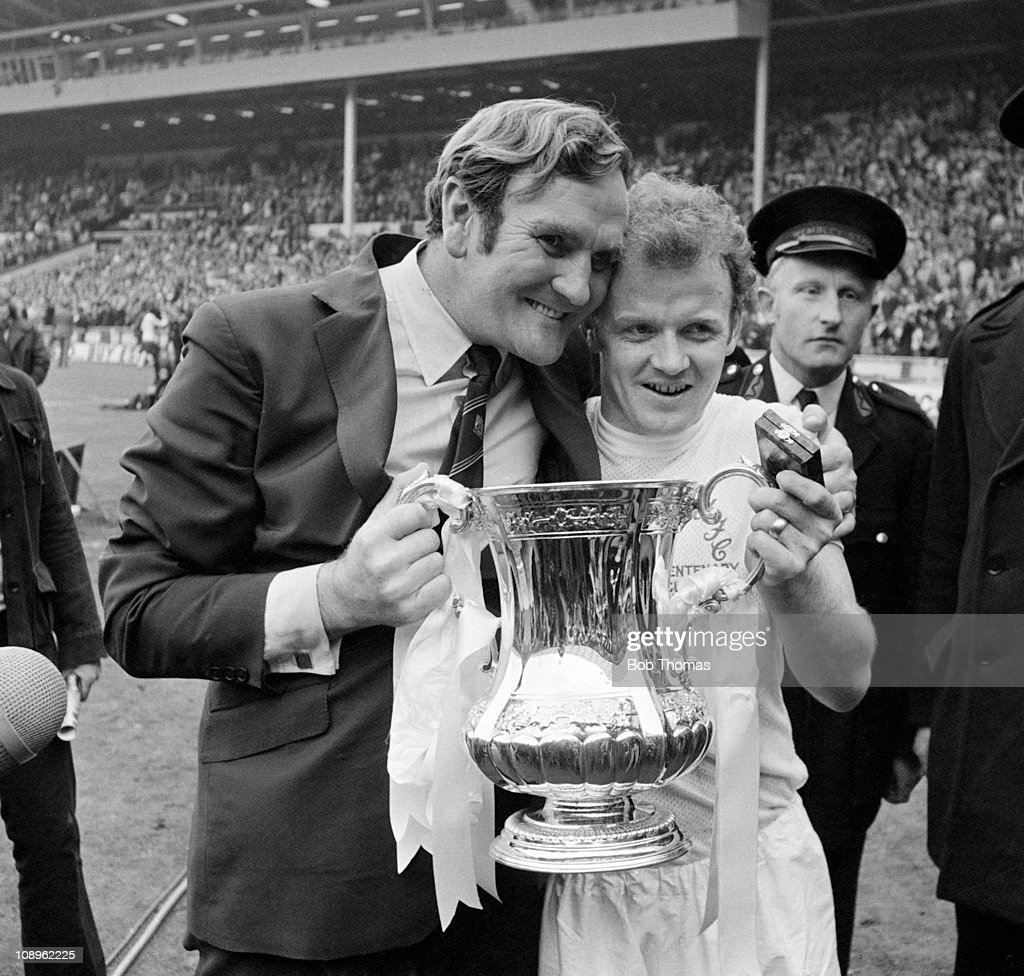 Leeds United captain Billy Bremner (right) and manager Don Revie celebrate with the trophy after the Leeds United v Arsenal FA Cup Final held at Wembley stadium, London on the 6th May 1972. Leeds United won the match 1-0.