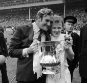 Leeds United captain Billy Bremner and manager Don Revie celebrate with the trophy after the Leeds United v Arsenal FA Cup Final held at Wembley...