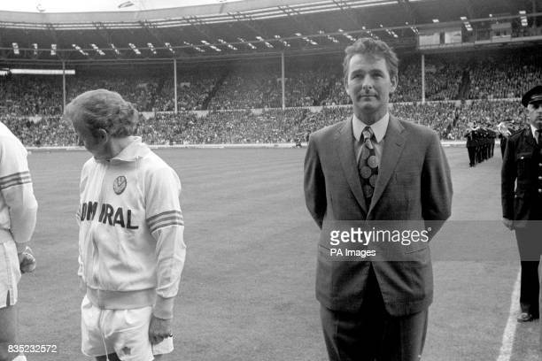 Leeds United captain Billy Bremner looks away from Manager Brian Clough as the teams lineup before the kick off