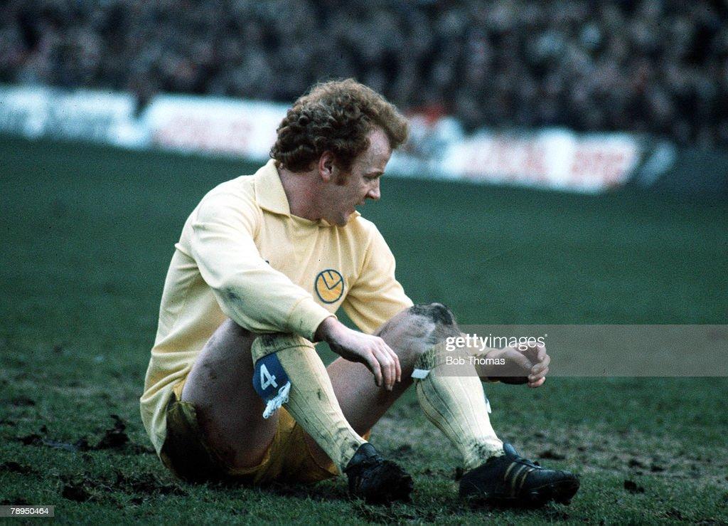 Leeds United captain Billy Bremner sits on the floor