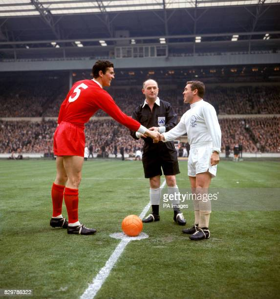 Leeds United captain Bobby Collins shakes hands with Liverpool captain Ron Yeats watched by referee W Clements