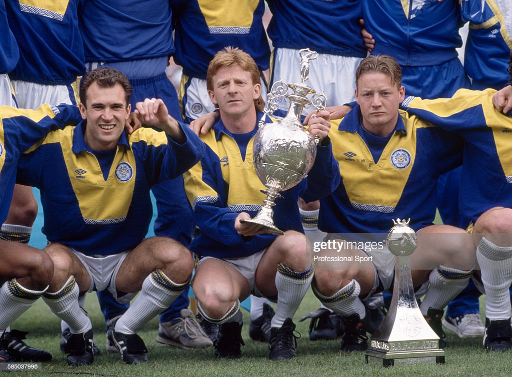 Leeds United captain Gordon Strachan, flanked by Tony Dorigo (left) and David Batty (right) with the Football League Division One trophy for the 1991/92 season at Elland Road on May 2, 1992 in Leeds, England.