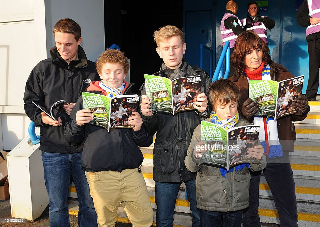 Leeds United fans read a speacial edition matchday programme prior to kick off during the npower Championship match between Leeds United and Millwall at Elland Road on December 03, 2011 in Leeds, England.