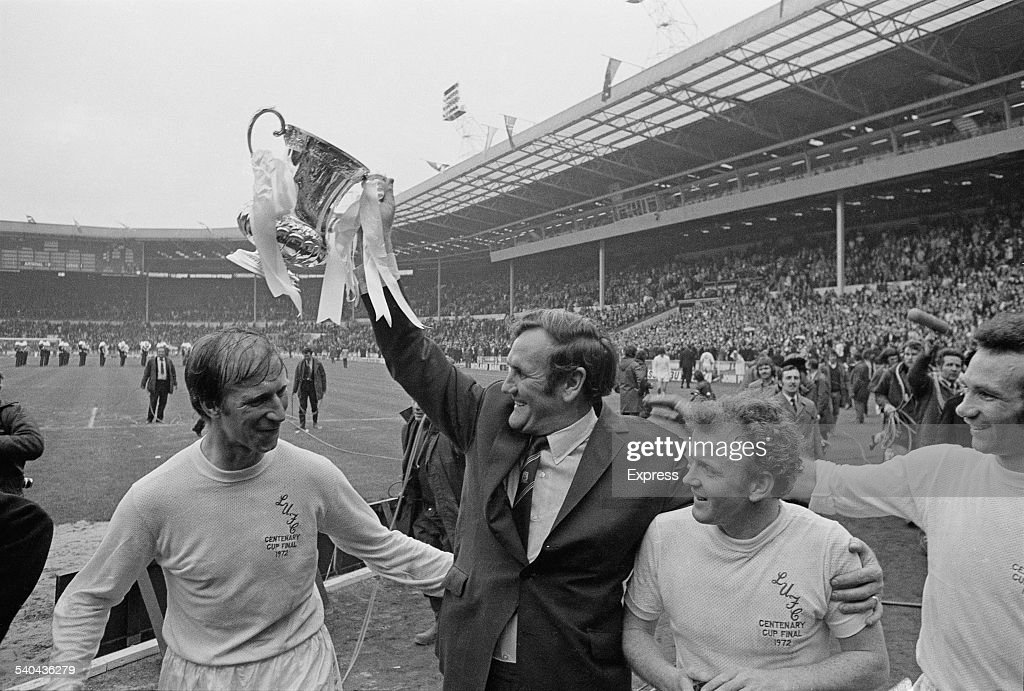 Leeds United F.C. manager <a gi-track='captionPersonalityLinkClicked' href=/galleries/search?phrase=Don+Revie&family=editorial&specificpeople=221739 ng-click='$event.stopPropagation()'>Don Revie</a> (1927 - 1989) lifts the 'FA Cup' trophy after his players beat Arsenal F.C. to win the FA Cup Final, Wembley Stadium, London, 6th May 1972. Also shown are <a gi-track='captionPersonalityLinkClicked' href=/galleries/search?phrase=Jack+Charlton&family=editorial&specificpeople=453447 ng-click='$event.stopPropagation()'>Jack Charlton</a> (left), Billy Bremner (1942 - 1997), and Paul Reaney (far right).