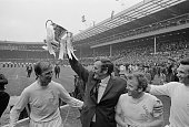 Leeds United FC manager Don Revie lifts the 'FA Cup' trophy after his players beat Arsenal FC to win the FA Cup Final Wembley Stadium London 6th May...