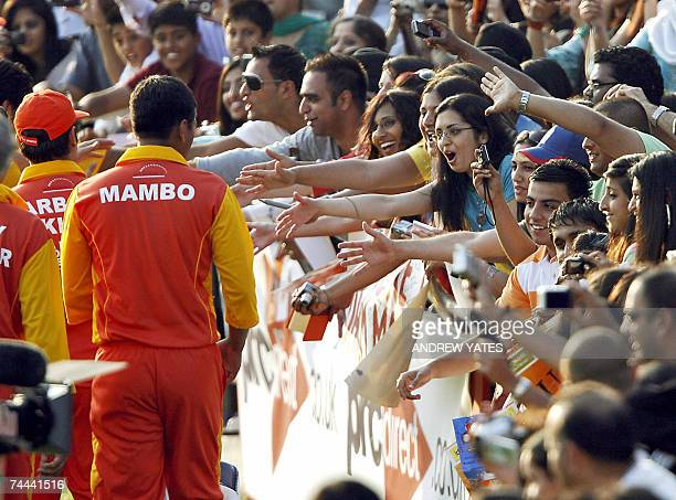 Cricket players meet their fans after the celebrity cricket match at Headingley Cricket ground 08 June 2007 during the International Indian Film...