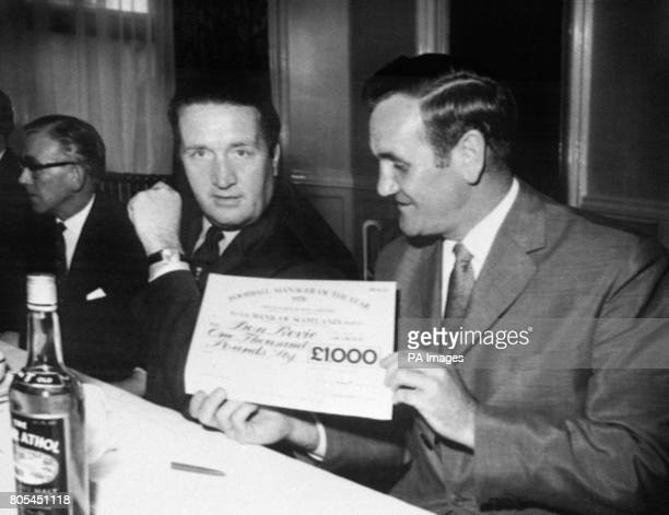 Leeds United Manager Don Revie holds his cheque for 1000 for winning the Manager of the Year award awarded by Arthur Bell and Sons In his speech he...