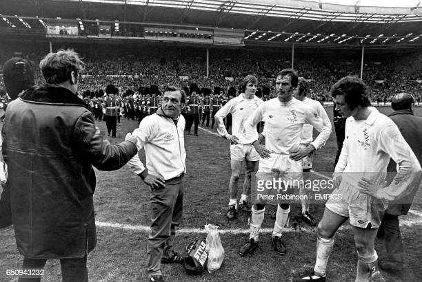 Leeds United manager Don Revie tries to console trainer Les Cocker and players Allan Clarke Paul Madeley Mick Jones and Trevor Cherry after their...