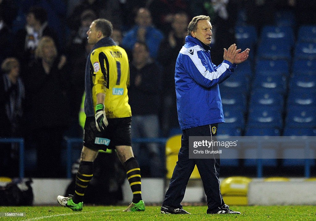 Leeds United manager <a gi-track='captionPersonalityLinkClicked' href=/galleries/search?phrase=Neil+Warnock&family=editorial&specificpeople=644786 ng-click='$event.stopPropagation()'>Neil Warnock</a> applauds the supporters following the npower Championship match between Leeds United and Middlesbrough at Elland Road on December 22, 2012 in Leeds, England.