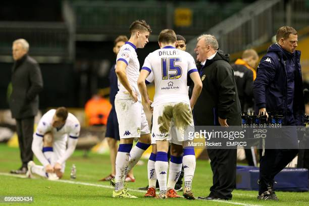Leeds United manager Steve Evans speaks with players Liam Bridcutt Stuart Dallas and Sam Byram during a break in play