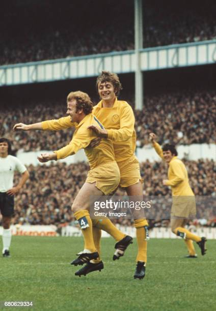 Leeds United player Billy Bremner is congratulated by striker Allan Clarke as Eddie Gray celebrates and Spurs defender Steve Perryman looks on after...