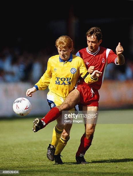 Leeds United player Gordon Strachan is challenged by Bournemouth player Shaun Brooks during a Second Division match between Bournemouth and Leeds...