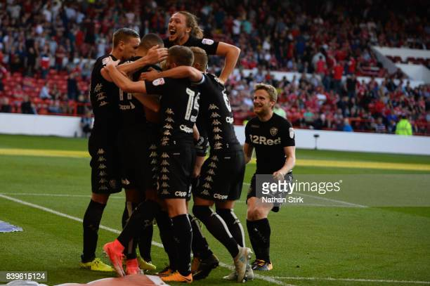 Leeds United players celebrate after scoring the second goal during the Sky Bet Championship match between Nottingham Forest and Leeds United at City...