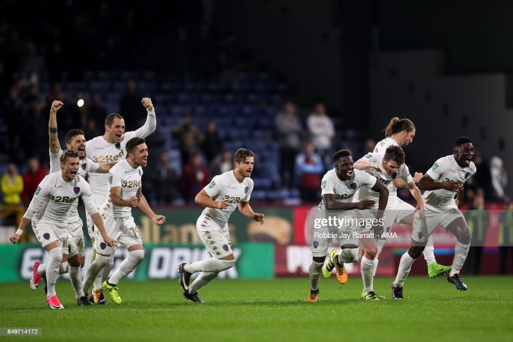 Leeds United players celebrate after winning the penalty shoot out during the Carabao Cup Third Round match between Burnley and Leeds United at Turf Moor on September 19, 2017 in Burnley, England.