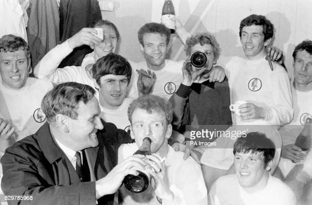 Leeds United players celebrate with champagne and cigars in the dressing room after drawing 00 with Liverpool a result which wrapped up Leeds' first...