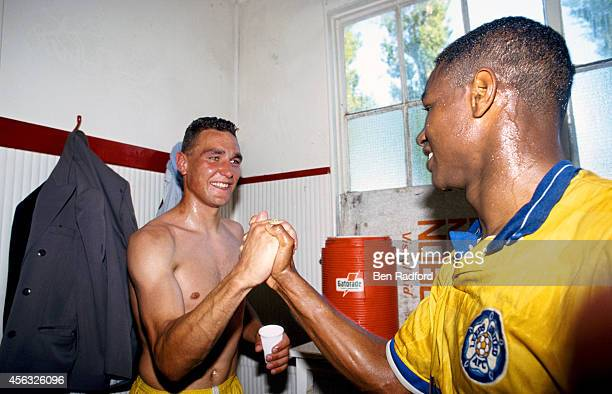 Leeds United players Vinnie Jones and Chris Fairclough celebrate after Leeds United had gained promotion to the 1st Division after a division two...