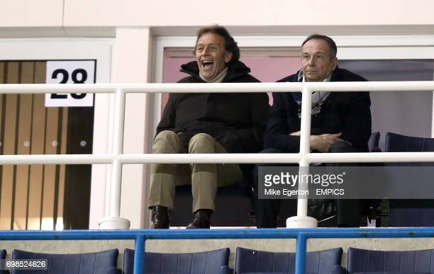 Leeds United 's banned owner Massimo Cellino watches the match from a private box