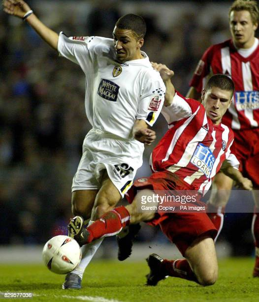 Leeds United's Aaron Lennon is tackled by Sheffield United's Nick Montgomery