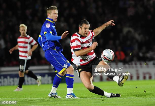 Leeds United's Adam Clayton and Doncaster Rovers' Jon Parkin battle for the ball during the npower Championship match at the Keepmoat Stadium...