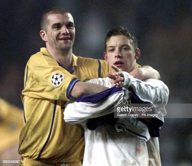 LEAGUE Leeds United's Alan Smith and Dominic Matteo celebrate their 41 win over Anderlecht during a UEFA Champions League match at the Stade Constant...