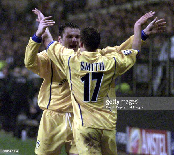 LEAGUE Leeds United's Alan Smith celebrates his goal with team mate Mark Viduka during the UEFA Champions League football match against Anderlecht at...