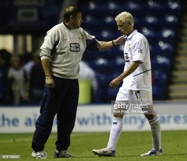Leeds United's Alan Smith is consoled by coach Steve Sutton following their 40 defeat against Leicester in the Barclaycard Premiership game at the...