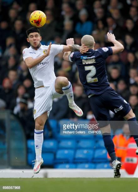 Leeds United's Alex Mowatt and Millwall's Alan Dunne challenge