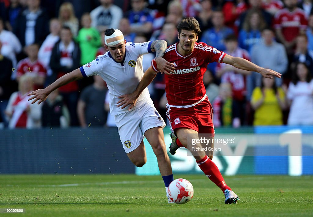 Leeds United's Alex Mowatt challenges Middlesbrough's George Friend during the Sky Bet Championship match between Middlesbrough and Leeds United at the Riverside on September 27, 2015 in Middlesbrou duringgh, England.