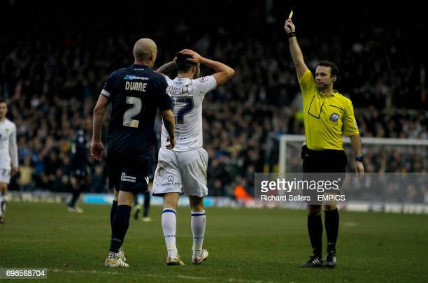 Leeds United's Alex Mowatt is booked for diving
